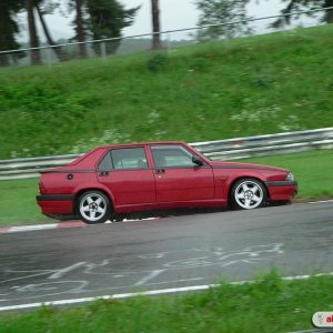 Nurburgring action in the soaking wet -- Alfa 75 TS